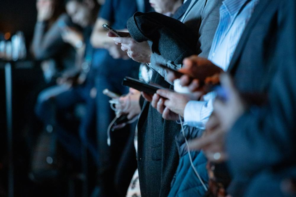 Many people using their smartphones